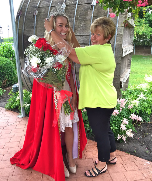 Claudia Zacharewicz of Jamesport is crowned Polish Town Queen by event co-chair Marianne Trubish Saturday. (Credit: Rachel Young)