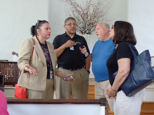 Annette D'Amato of the USPS (left) speaks with South Jamesport residents at Wednesday's meeting at the Jamesport Meeting House. (Credit: Claire Leaden)