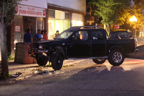 A taxi cab crashed into this parked pickup truck Sunday night, officials said. (Credit: Jennifer Gustavson)