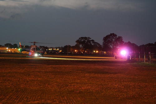 A county police helicopter prepares to airlift a crash victim near Pulaski Street School in Riverhead Sunday night. (Credit: Jennifer Gustavson)