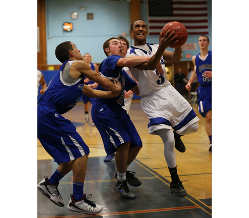 DANIEL DE MATO PHOTO | Riverhead senior Quinn Funn is hacked on the arm as he goes up for a shot last week against Centereach.