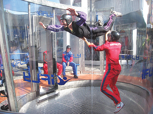 COURTESY PHOTO | People skydiving in a vertical wind tunnel. Skydive Long Island is looking to build a new indoor skydiving facility in Calverton.