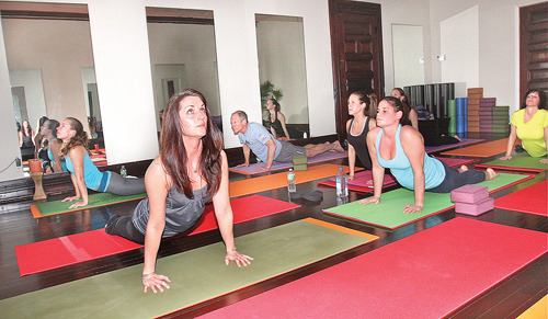 BARBARAELLEN KOCH FILE PHOTO  |  April Yakaboski (second from left) leads a 'hot yoga' class at her West Main Street studio in Riverhead.