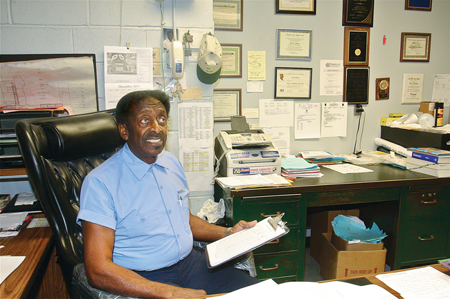 Carl James in his office last year at Pulaski Street School in Riverhead. Mr. James, 79, retired in June after working in the building for nearly 54 years as a custodian. (Credit: Barbaraellen Koch, file)
