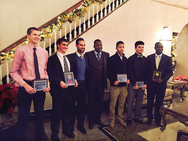 Members of the Riverhead High School boys soccer team showed off their awards at the awards dinner in Holbrook. From the left, goalkeeper Ryan DiResta (all-conference), defender Noah Markewitz (academic all-county), varsity coach Andrew Aleksandrowicz, varsity coach Lamine Traore, defender Ever Bonilla (all-conference), forward Anthony Antunes (all-league) and junior varsity coach Moussa Keita (junior varsity coach of the year). (Credit: Courtesy)