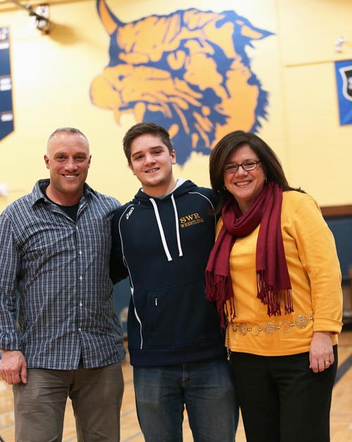 James Suarez with his parents Joe and Kalli on Senior Day at Shoreham-Wading River High School. (Credit: Garret Meade)
