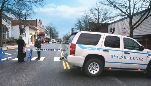 Barbaraellen Koch photo  |  A Riverhead Community Oriented Police Enforcement vehicle blocks off East Main Street for the opening of the Suffolk Theater last year.
