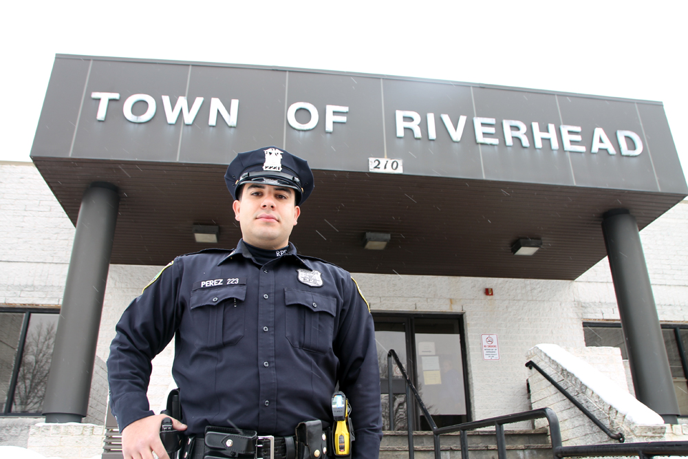 Byron Perez, the first full-time Hispanic cop on the town's police force and a lifelong Riverhead resident, says his goal is to give back to his hometown. As a volunteer instructor with Riverhead Commmunity Awareness Program, he serves as a positive role model for local students.