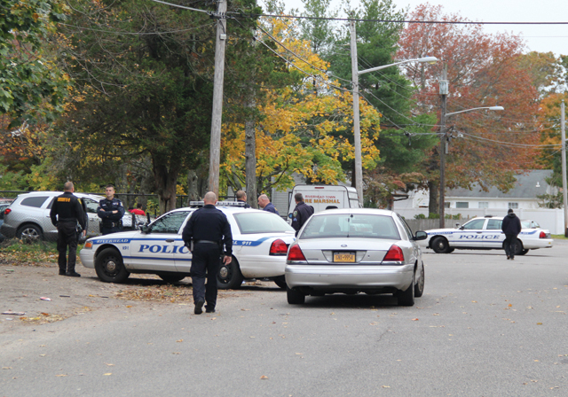 Police raid 29 Lewis Street in the Millbrook Gables section of Riverhead Nov. 13. (Credit: Carrie Miller, file)
