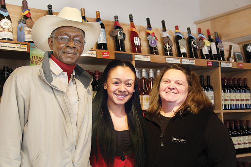 CARRIE MILLER PHOTO | Heather Riley (center ) with her parents Willie and Lori at Martha Clara Winery where they work.