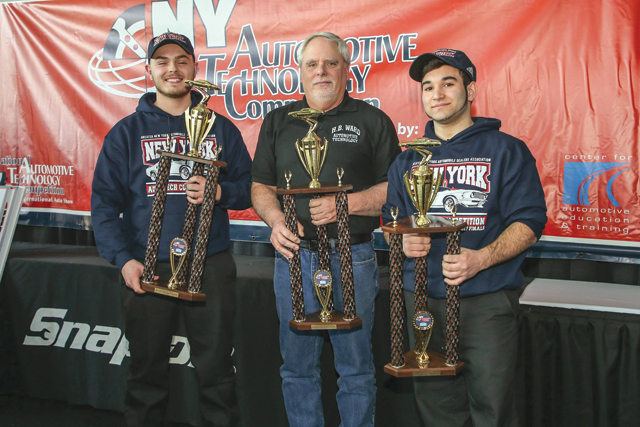 Evan Wagner (from left), teacher Mike O'Hara and John DeLuca with their first-place trophies Feb. 14 at the state competition. (Credit: courtesy photo)