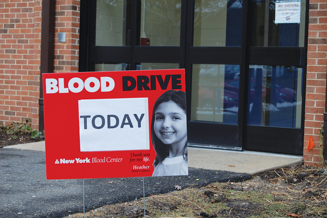 A sign outside SCCC's Peconic Building indicates a blood drive taking place inside. According to the New York Blood Center, someone in the U.S. needs a blood transfusion every three seconds. (Credit: Nicole Smith)