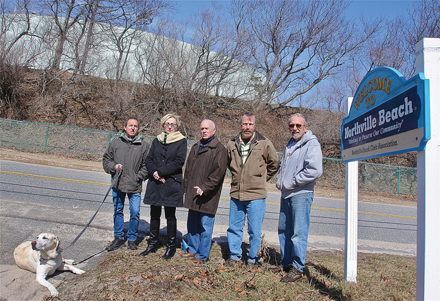 Opponents of the Riverhead Terminal expansion on Sound Shore Road Monday afternoon (from left): Northville Beach Civic Association president Neil Krupnick, Ann Weiser, Greg Genovese of the Highlands Club community, John Cullen and Dave Gruner. (Credit: Barbaraellen Koch)