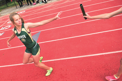 McGann-Mercy sophomore Meg Tuthill reaches back for the baton during a relay event last year. (Credit: Bill Landon, file)