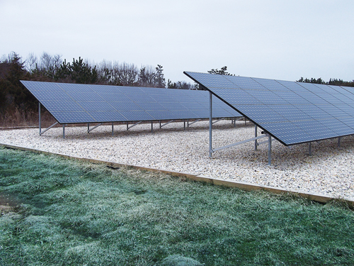 GREENLOGIC COURTESY FILE PHOTO  |  A ground-mounted solar array similar to one that was installed on Gabrielsen Farms' Aquebogue greenhouse.