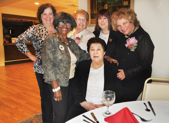 Members (counter-clockwise, from left) Sissy Zosimo, Diann Scott, Joanne Zosimo, Darlene Faith, Marie Donovan and Thelma Booker pose for a photo Saturday at the Madison Street Moose lodge. (Credit: Rachel Young)