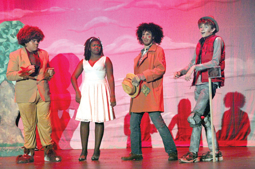Jesse Goodale (the Lion), Taylor Burgess (Dorothy), Jon Troiano (the Scarecrow) and Alex Bowe (the Tinman) perform in the Blue Masques production of 'The Wiz' at Riverhead High School. (Credit: Riverhead Schools)