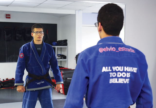 I loved this portrait of Riverhead High School junior Elvio Estrada, 17, who competed in the world Brazilian jiu-jitsu competition in June. The view from behind, featuring his motto, says it all. (Credit: Paul Squire)