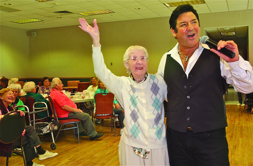"BARBARAELLEN KOCH PHOTOVirginia Messina, 96, of Riverhead, took center stage Thusday afternoon with singer Larry Liso of Aquebogue as he serenaded her with his rendition ""I Left my Heart in San Francisco"" during the entertainment day for seniors hosted by Riverhead Town at the human resource/senior center Thursday afternoon. Pianist Danny Keyes also performed."