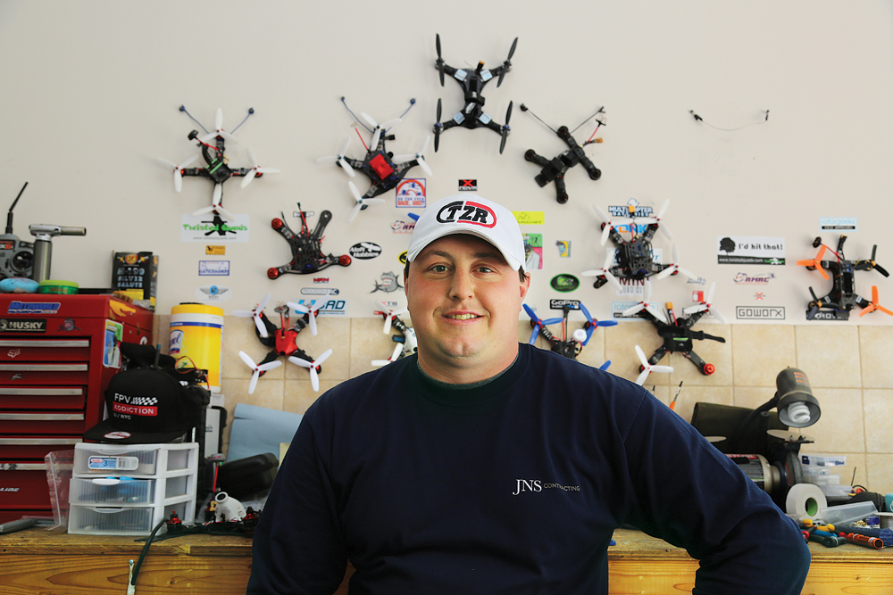 A business owner by day, Mr. Zoumas has custom built his racing drones, which hang on his garage wall. (Credit: Paul Squire)