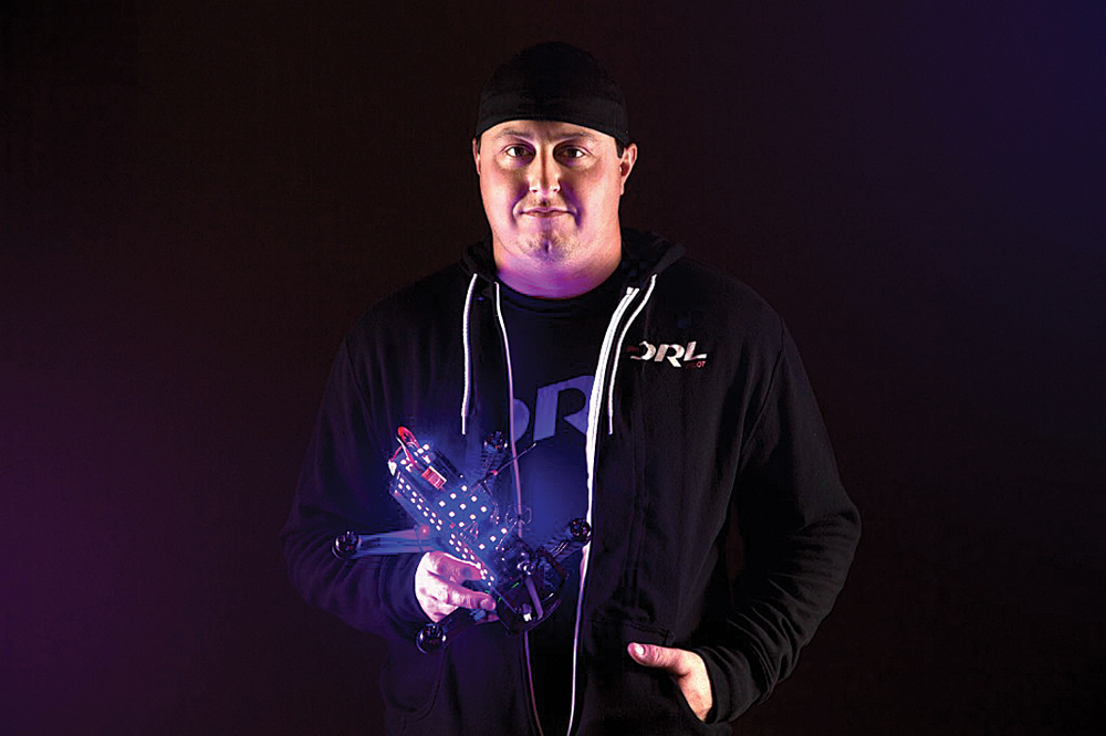 DRL pilot Steve Zoumas poses with his winning racing drone. (Credit: Courtesy, Drone Racing League)