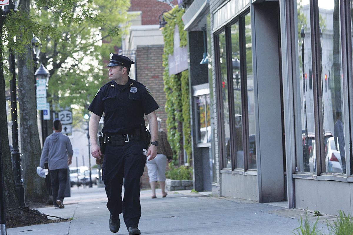 Officer Montalnano walks his beat on East Main Street last week. (Credit: Barbaraellen Koch, file)