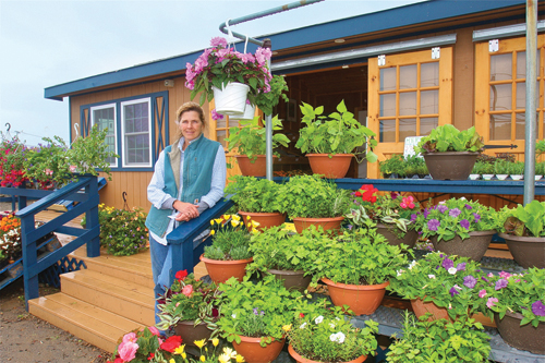Farmer Debbie Schmitt at her new semi-mobile farmstand that she had built toward the end of 2013 on Sound Avenue in Riverhead. (Credit: BARBARAELLEN KOCH )