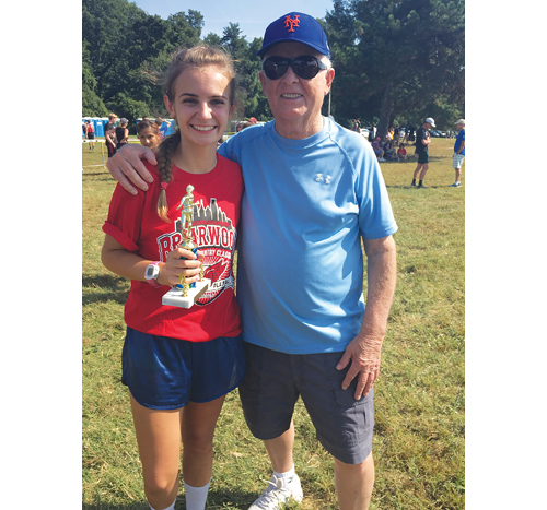 Caleigh and her grandfather, Curt Davis, after a cross country race earlier this year. (Courtesy photo)