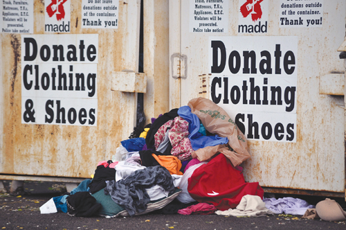 A clothing bin in the TJ Maxx shopping center was overfilled with clothes this week. (Credit: Grant Parpan)