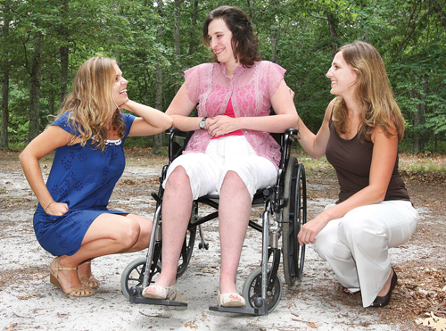 Elizabeth Rather, 26, of Riverhead with her friends Lisa Zamber (left) and Rachel Allen. Friends of Elizabeth is planning its sixth annual fundraiser to help pay for Ms. Rather's medical costs after she was diagnosed with multiple sclerosis. (Credit: Barbaraellen Koch)