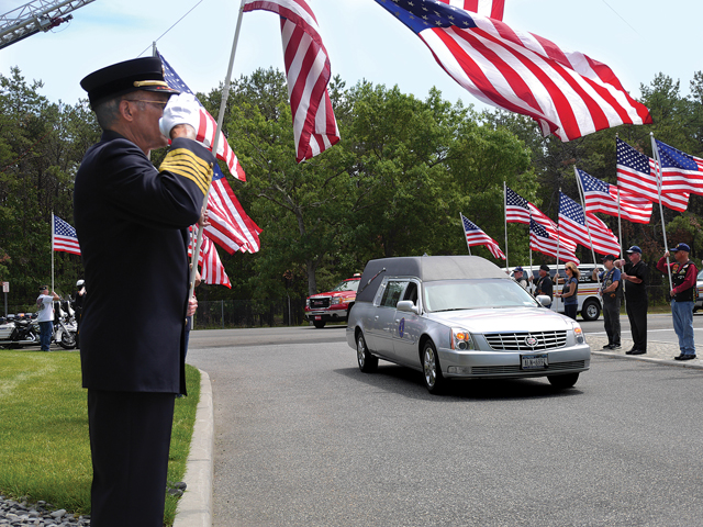 Seeing the hearse entering Calverton National Cemetery for the May funeral of Battalion Chief Lawrence Stack was incredibly powerful. He lost his life on Sept. 11, 2001 and his body was never recovered. That day they buried a vial of blood he had donated. (Credit: Krysten Massa)