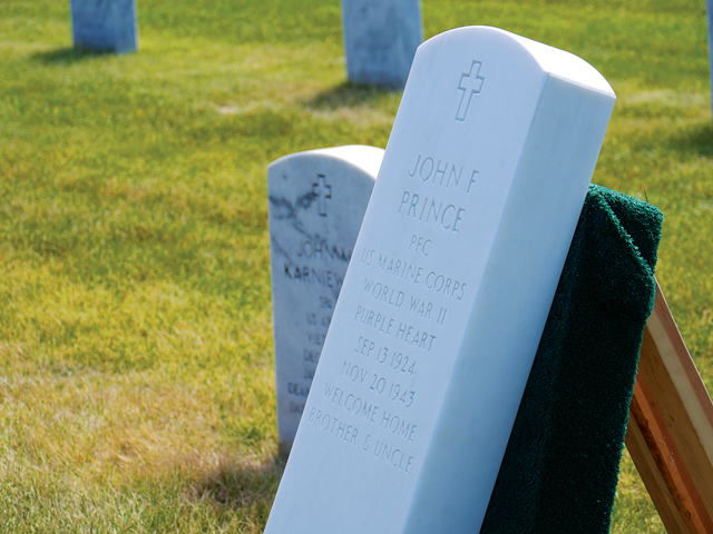 The gravestone of U.S. Marine John Prince at Calverton National Cemetery. (Credit: Krysten Massa)