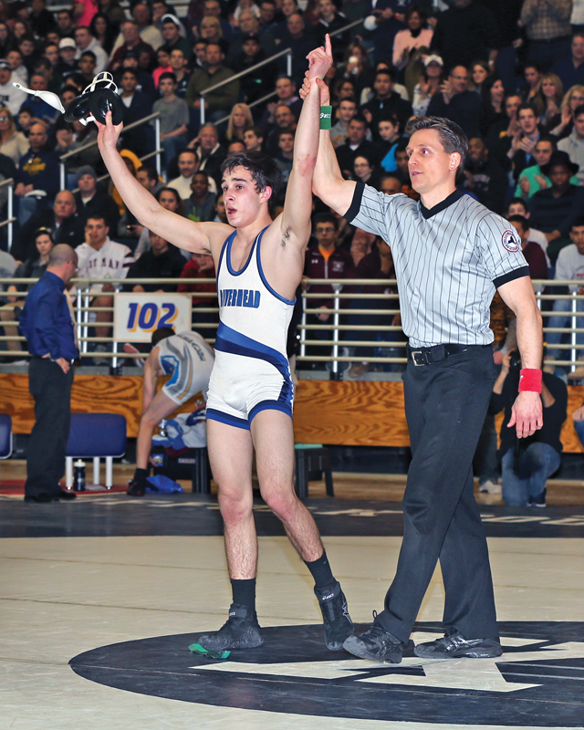 Ed Matyka of Riverhead (white and navy singlet) defeated Ben Tepperman of Hauppauge  (eagle singlet) in the 120 Lbs weight class. The Suffolk High School Division I Wrestling Championships were held at Hofstra University  on Feb. 15 2015Daniel De Mato