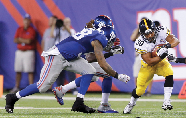 Miguel Maysonet carries the ball against the New York Giants in the team's preseason opener at MetLife Stadium. (Credit: AP/Frank Franklin II)