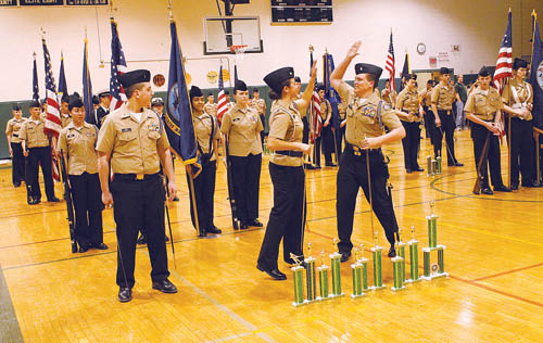 PAUL SQUIRE PHOTO  |  Ensign Thomas Kopp watches as Lt. Amanda Gallo and Ensign Harold Hubbard high five after Riverhead was announced as the winner of the annual drill meet in Mastic Saturday afternoon.