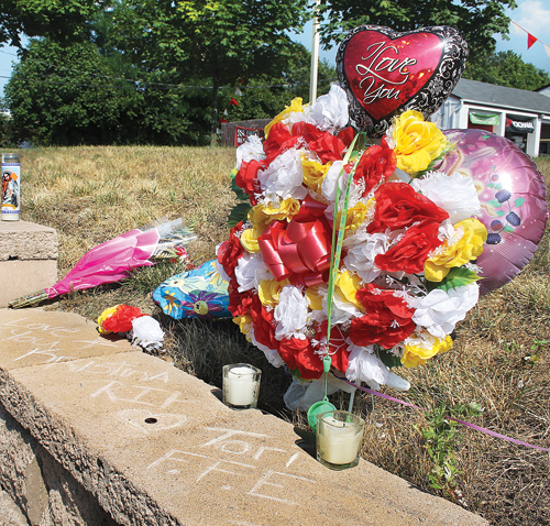 Friends set up a memorial on Route 58 for hit-and-run victim Kristina Tfelt a few days after her death. (Credit: Paul Squire, file)