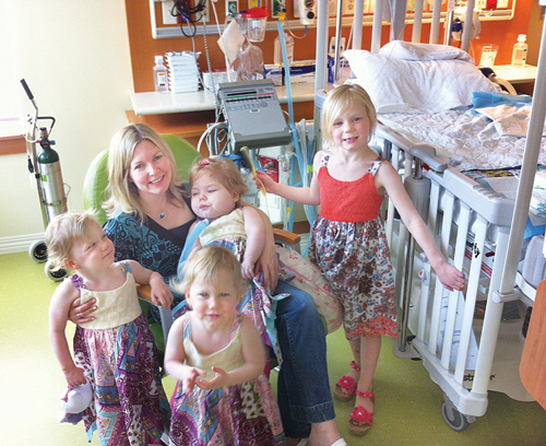 COURTESY PHOTO  |  Karen Serva with her 3-year-old triplets, Caroline (in her mother's arms), Abigail and Bridget, and 5-year-old daughter, Emily. The family traveled four hours round-trip during each visit to visit Caroline in Westchester County.