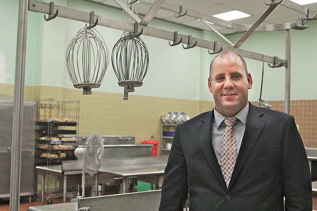 Keith Graham, the new food services director for Riverhead School District, in the high school kitchen. Mr. Graham says the district will be able to offer fresher foods to all students once kitchen renovations in each school are completed. (Credit: Jen Nuzzo)