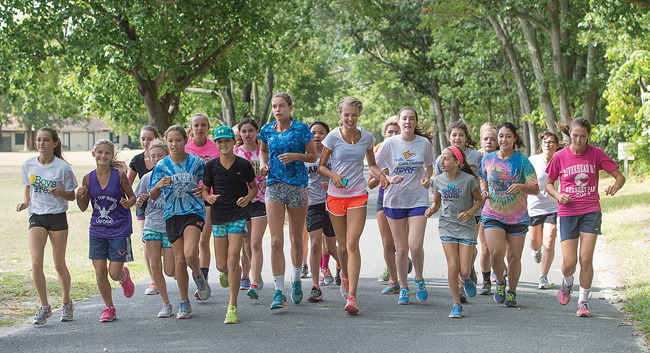 The Riverhead girls cross country team prepares for the season at practice last week. (Credit: Robert O'Rourk)