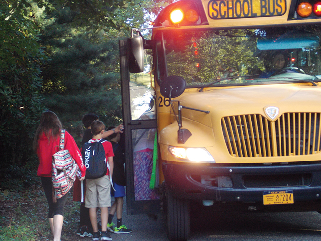 Ten students board a school bus at Hulse Avenue and 17th Street Monday morning. (Credit: Joseph Pinciaro)