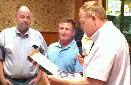 MICHAEL WHITE PHOTO | Rich Podlas (left) and Chuck Thomas (middle) were honored for their service to the Behr family at the first dinner in 2011.