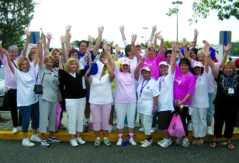 Breast cancer survivors celebrate at Sunday's walk.