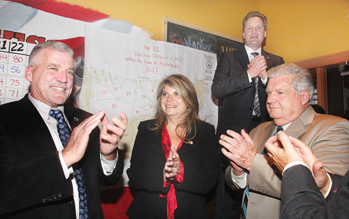 BARBARAELLEN KOCH FILE PHOTO  |  Riverhead Republicans celebrate their victorious sweep Election night in downtown Riverhead. From left: committee chairman Mason Haas, Councilwoman Jodi Giglio, Supervisor Sean Walter and Councilman John Dunleavy.