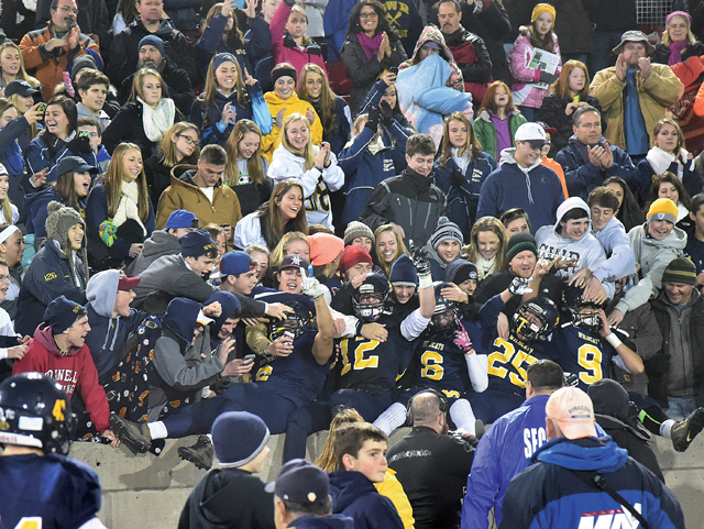 This photo taken after the Shoreham-Wading River football team's L.I. championship victory won in the sports feature photo category in the New York Press Association's Better Newspaper Contest. (Credit: Robert O'Rourk, file)
