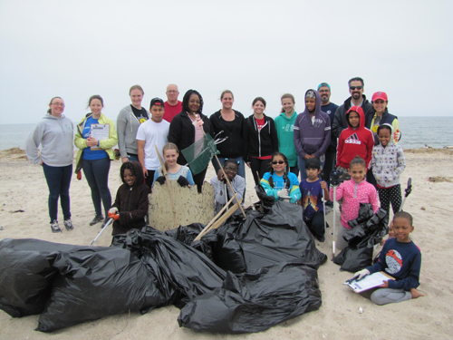 Riverhead Charter School kids filled up several bags with garbage they cleaned at Iron Pier beach Saturday