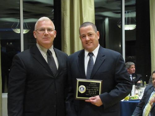 Captain Richard Smith, left, presents Det. Frank Hernandez with Riverhead's Officer of the Year Award Friday