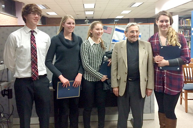 Riverhead High School students Jeremy Bornstein, Amanda Baron, Mieko Vail and Samantha Dunn with Holocaust survivor Werner Reich. (Credit: Riverhead School District)