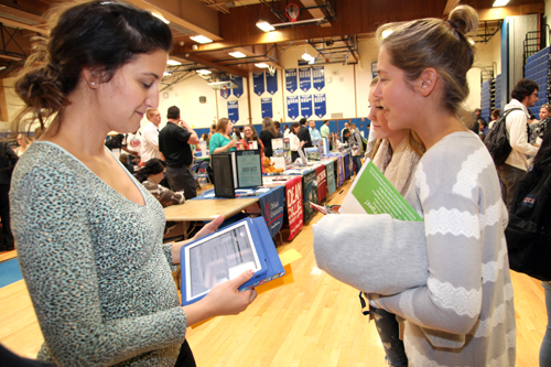 RHS Guidance Counselor Anastasia Cobis brought her iPad to the College Fair to help seniors find out if the colleges they took literature from had the their desired major. (Courtesy RCSD)