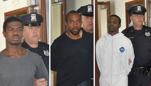 JOE PINCIARO PHOTOS |  Ishawn Jackson, Jhmil Dawson and Lavon Dawson being escorted into town court on Thursday.