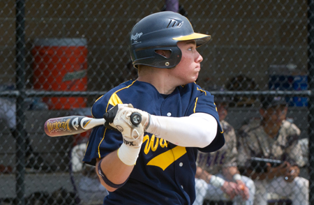 ROBERT O'ROURK PHOTO  |  Shoreham-Wading River senior Andrew Nicchi hit a two-run home run in the first inning Monday as Shoreham won 12-1 at Sayville.